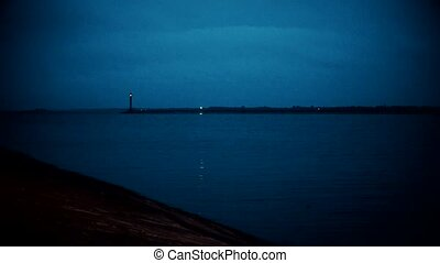 Blinking lighthouse at night