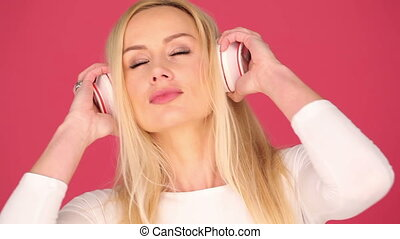 Blisful young woman listening to music