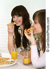Bliss Caucasian couple of people sitting eating pizza