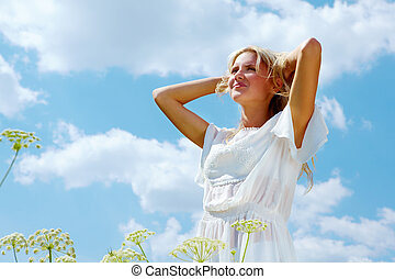 Image of happy female enjoying life on summer day