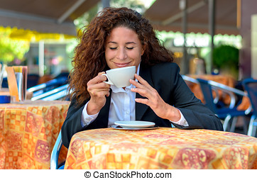 Blissful woman savoring the aroma of her coffee