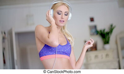 Blissful young woman listening to music