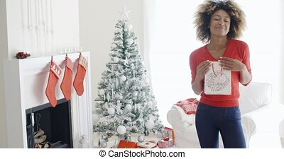 Blissfully happy young woman with a Xmas gift