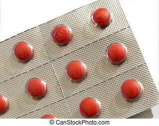 blister pack of over the counter red pills isolated on white...