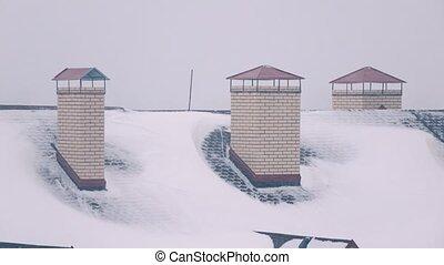 Blizzard above residential houses in winter 4K shot