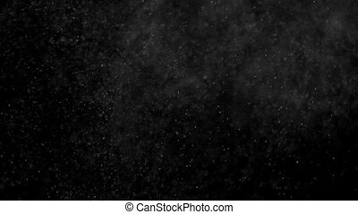 Blizzard Night - Small white particles flow in the air on a...