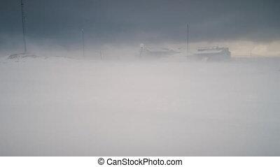 Blizzard over Vernadsky base. Antarctica shot. - Blizzard...
