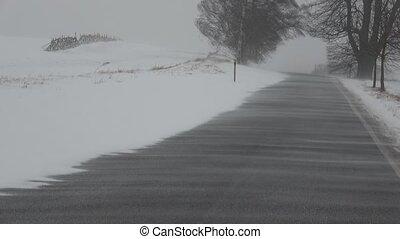 Blizzard snowstorm winter road of a snowy landscape....