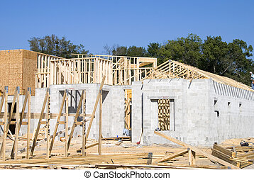 Block and frame home under construction and a clear day