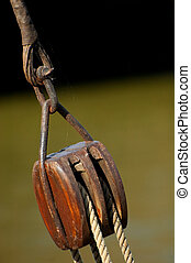 block and tackle lifting equipment on a boat