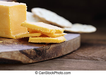 Block of Cheddar Cheese with Slices