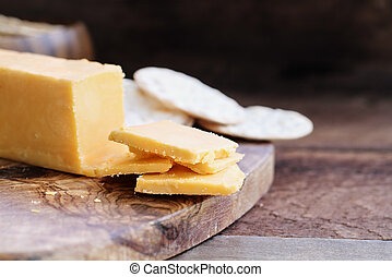 Block of Cheddar Cheese with Thin Slices