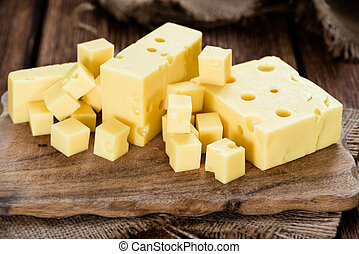 Block of Cheese (close-up shot) on vintage wooden background
