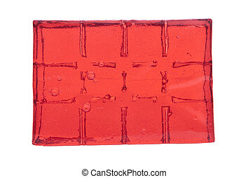 Block of red jelly cubes on white background