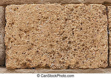 block of tuff on wall of medieval palace