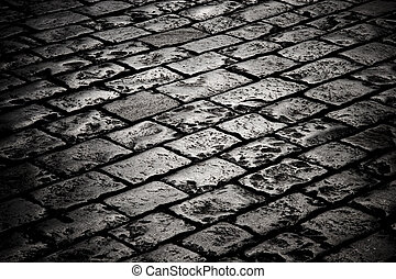 Block pavement in the darkness - Closeup of block pavement ...