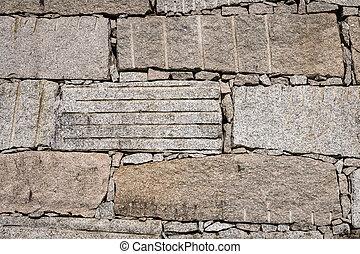 Block retaining wall made of big granite stones