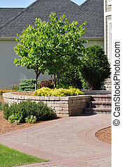 Block Sidewalk and Retaining Wall at a Residential Home