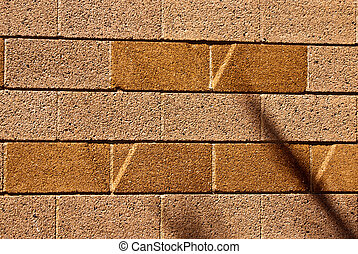 Block wall with V shapes