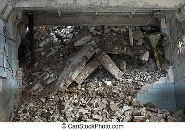Blockage of concrete fragments of the remains of the slab, bricks of the destroyed building. Background