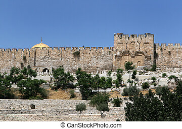 The blocked Eastern Gate on the Old City Wall of Jerusalem, Israel is traditionally known as the gate through which Jesus Christ will return when he returns to earth.