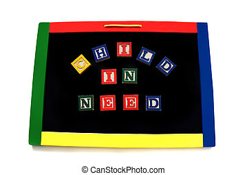 Blocks Letters Spell Child in Neesd on Magnetic Board
