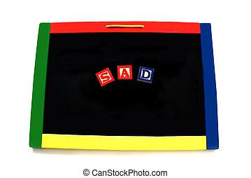 Blocks Letters Spell Sad on Magnetic Board