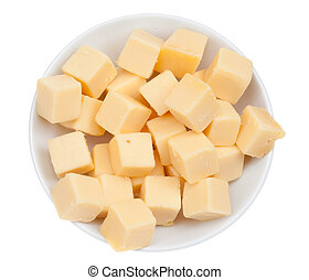 blocks of cheese in a bowl isolated