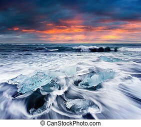 Blocks of ice washed by the waves on Jokulsarlon beach.