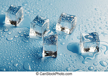 Blocks of Ice With water Drops close-up. Macro ice refreshing cube for a drink on a hot day