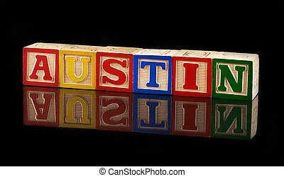 Blocks that spell Austin on black