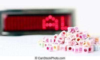 Blocks with letters rotate around forward scoreboard - white...