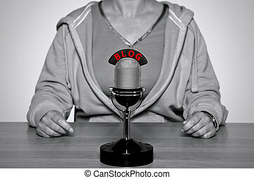 BLOG microphone - Woman sat at a desk with a retro...