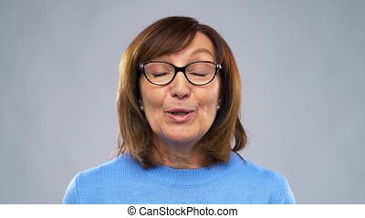 woman or blogger in glasses video blogging - blog, old age...