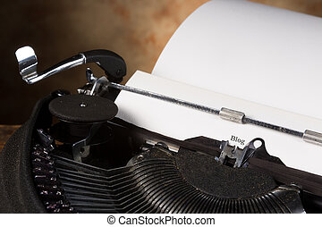 Blog page - Antique typewriter with an empty page and the ...