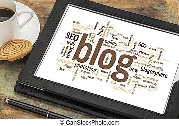 blog word cloud on digital tablet - cloud of words or tags...