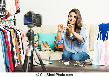 Blogger giving advice on accessories - Cute young female...