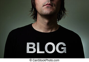 """Artistic portrait of a blogger with hiddenidentity in a black shirt with a big title """"BLOG"""" on his chest."""