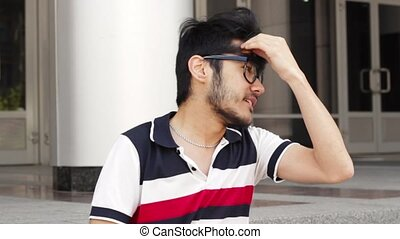 Blogger talking in camera in windy day - Blogger man talking...
