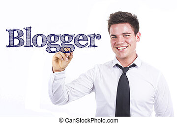 Blogger - Young smiling businessman writing on transparent surface