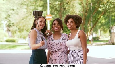 women or bloggers recording video by smartphone - blogging,...