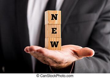 blokjes, houten, tekst, -, vasthouden, zakenman, nieuw