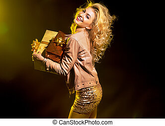Blond alluring girl holding the gifts