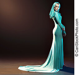 Blond alluring lady dressed in evening gown