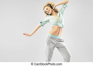 Blond alluring woman dancing alone