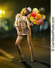 Blond alluring woman with balloons