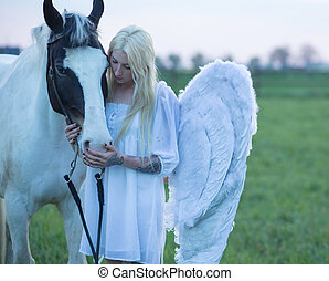 Blond angel looking after the horse - Blond angel looking...