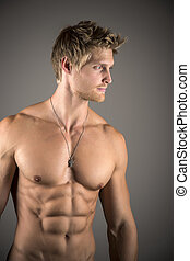 Blond athletic man with well developed abs and pecs