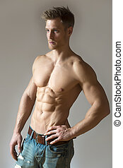 Blond athlete - Well trained sport man with pectoral and ...