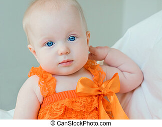 Blond baby girl with blue eyes